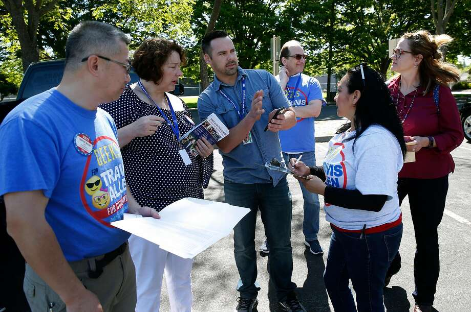 Brandon Wood (center) organizes a team of volunteers before the group fans out across a neighborhood to canvass for Republican gubernatorial candidate Travis Allen in Concord, Calif. on Saturday, April 21, 2018. Photo: Paul Chinn / The Chronicle