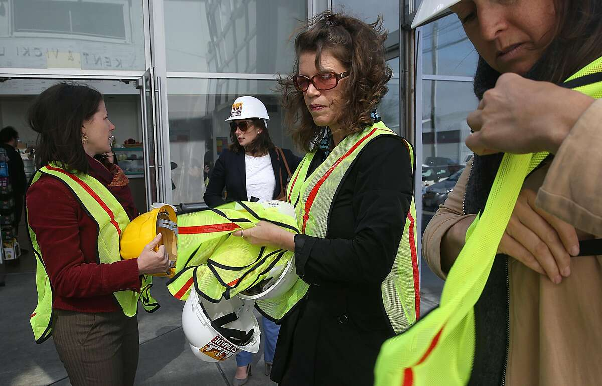 SFMade CEO Katie Sofis (middle right) prepares to give a tour of the new PDR/industrial building at 100 Hooper St., near Mission Bay on Wednesday, April 25, 2018, in San Francisco, Calif.