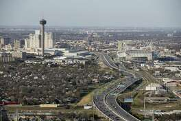 Traffic moves along IH-37 between the Tower of the Americas and the Alamodome, Thursday, Feb. 18, 2016.