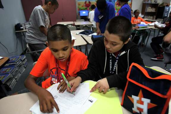 Jordan Taylor and Cesar Cerrantes finish their social studies group activity at Macario Garcia Middle School on April 18, 2013, in Sugar Land. Improving educational opportunities will be a priority for the Texas Senate Hispanic Caucus, says the new chairman.