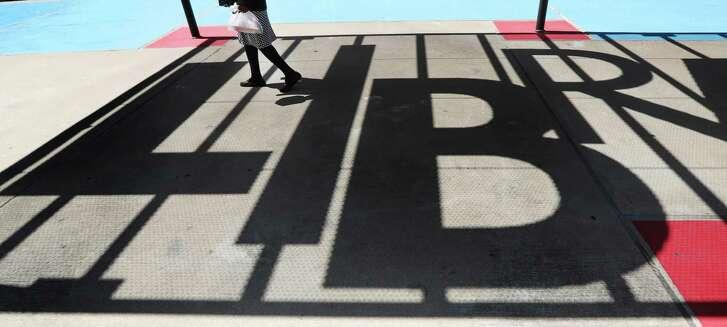 A women walks though the Barbara Bush Literacy Plaza Thursday, April 19, 2018, in Houston. ( Steve Gonzales / Houston Chronicle )