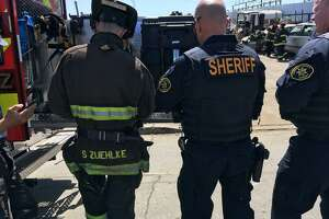 Alameda County sheriff's deputies and Oakland firefighters were at an East Oakland tow yard Wednesday afternoon to investigate possible radioactive emissions coming from a vehicle.
