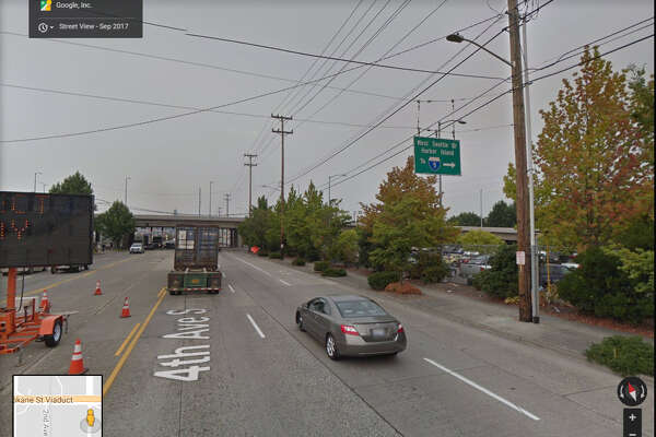 A sign on Fourth Avenue South in Sodo misleads drivers into thinking they can turn right and get onto the West Seattle Bridge. This is not exactly a reality.