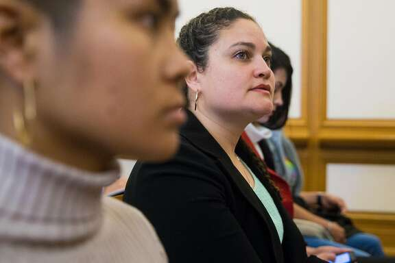 Sexual assault survivor Audrey Amort listens while sitting in the front row before speaking in public comment during a Public Safety and Neighborhood Services Committee hearing held by Supervisor Hillary Ronen related to the alleged mishandling of sexual assault cases by the City of San Francisco at San Francisco City Hall Wednesday, April 25, 2018 in San Francisco, Calif.