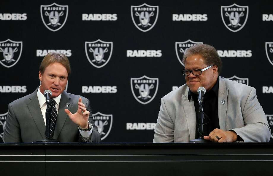 FILE - In this Jan. 8, 2018, file photo, Oakland Raiders new head coach Jon Gruden, left, answers a question next to general manager Reggie McKenzie during an NFL football news conference in Alameda, Calif. The approach McKenzie takes into the NFL draft is no different with Gruden as coach than it was in previous years with Jack Del Rio and Dennis Allen at the helm. (AP Photo/Marcio Jose Sanchez, File) Photo: Marcio Jose Sanchez / Associated Press