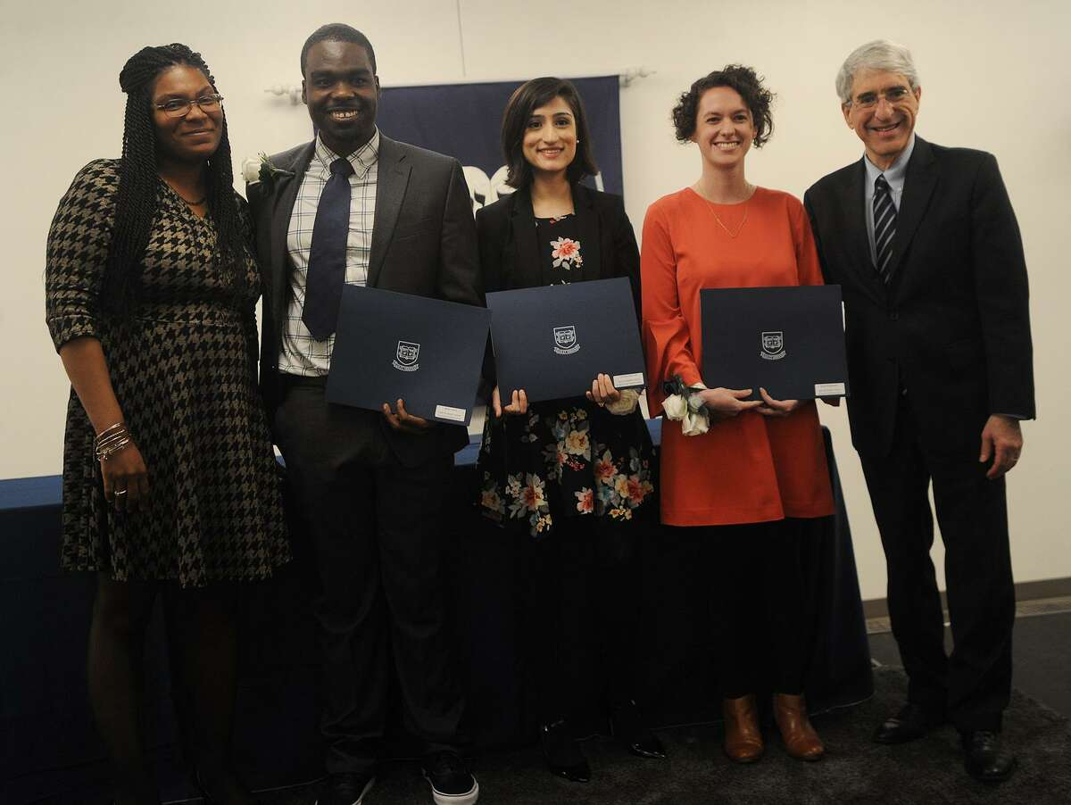 From left; New Haven Board of Alders President Tyisha Walker-Myers, Graduate Ivy Award recipients Robert Rock, Tehreem Rehman, and Kayla Ringelhelm, of the Yale United States Health Justice Course & Collaborative, and Yale University President Peter Salovey pose for a photo during the annual Seton Elm-Ivy Awards at Yale on York in New Haven, Conn. on Wednesday, April 25, 2018.