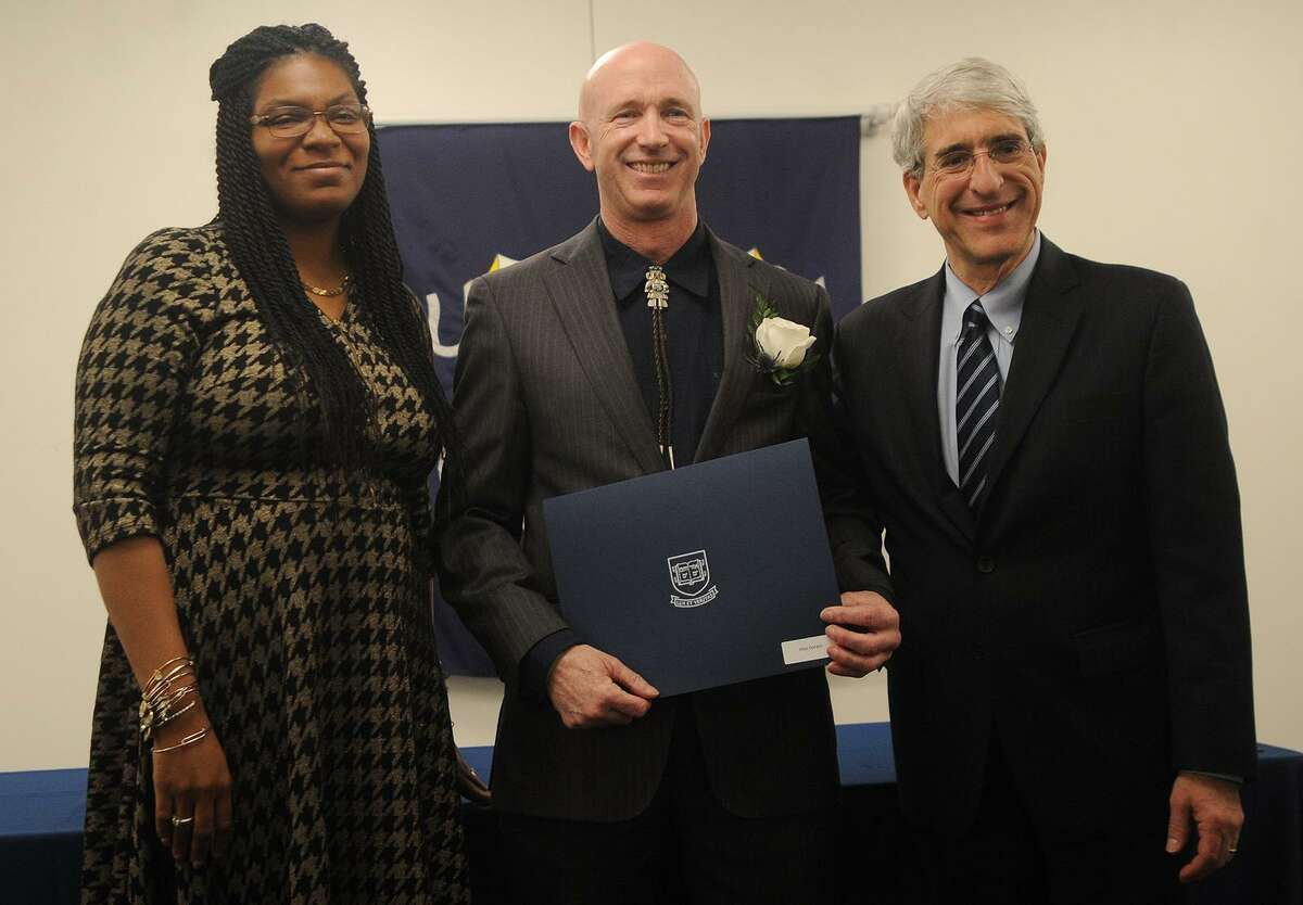 From left; New Haven Board of Alders President Tyisha Walker-Myers, Ivy Award recipient Alex Dorato, and Yale University President Peter Salovey pose for a photo during the annual Seton Elm-Ivy Awards at Yale on York in New Haven, Conn. on Wednesday, April 25, 2018. Dorato is the president of the Board of Directors of New HYTEs, raising awareness on the value of providing tennis as a pathway to wellness and higher education.