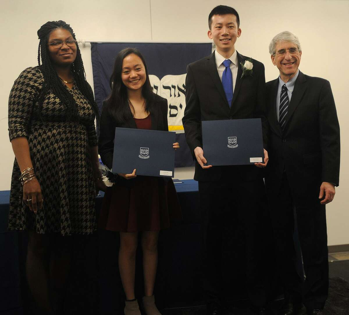From left; New Haven Board of Alders President Tyisha Walker-Myers, Undergraduate Ivy Award recipients Annie Chen and Dennis Duan, of Code Haven, and Yale University President Peter Salovey pose for a photo during the annual Seton Elm-Ivy Awards at Yale on York in New Haven, Conn. on Wednesday, April 25, 2018. Yale students in Code Haven teach computing skills at several New Haven schools.