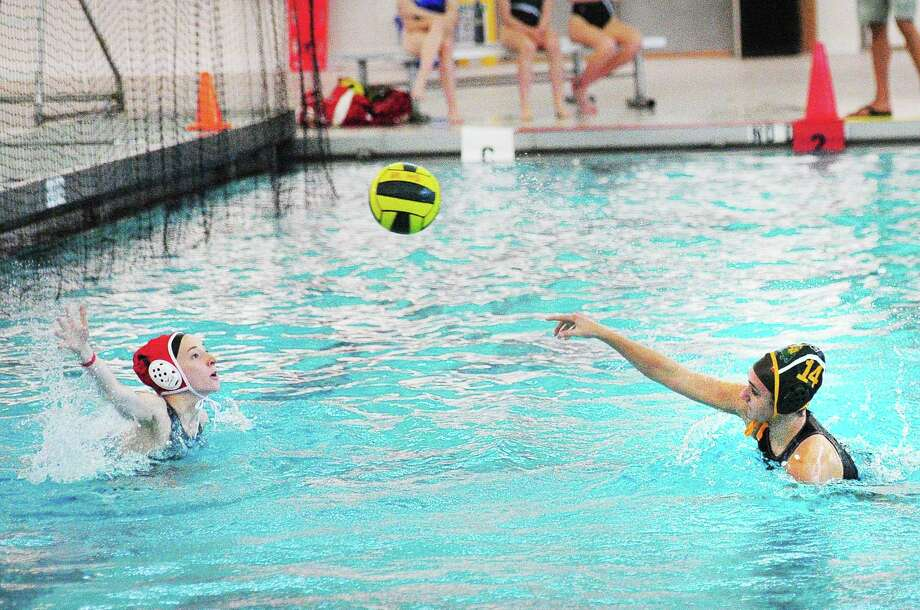 At right, Kaitlin Ganshaw (#14) of Greenwich Academy beats Sacred Heart goalie Ella Holl to score during the girls high school waterpolo match between Greenwich Aademy and Sacred Heart Greenwich at the YMCA of Greenwich, Conn., Wednesday, April 25, 2018. Photo: Bob Luckey Jr. / Hearst Connecticut Media / Greenwich Time
