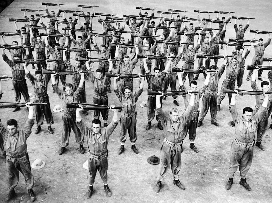 Recruits at the U.S. marine base on Parris Island, S.C., doing rifle drill as part of their training in 1942. Photo: ASSOCIATED PRESS / Internal