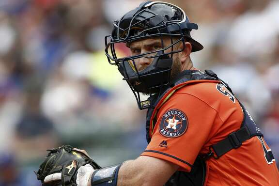 Houston Astros' catcher Max Stassi (12) looks towards the dugout during a baseball game against the Texas Rangers Sunday, April 1, 2018, in Arlington, Texas. (AP Photo/Mike Stone)