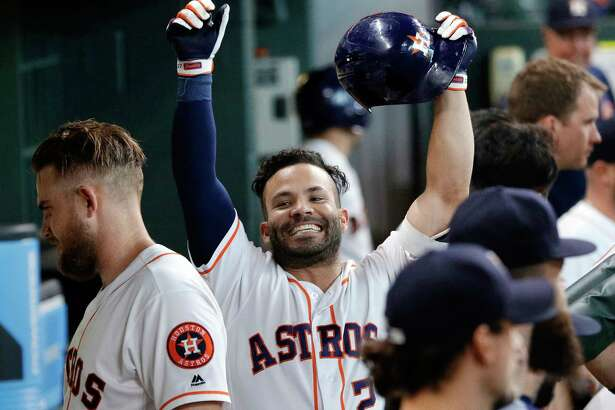 Houston Astros' second baseman Jose Altuve (27) raises his arms in celebration in the dugout after hitting a home run against the Los Angeles Angels during the sixth inning of a baseball game Wednesday, April 25, 2018, in Houston. (AP Photo/Michael Wyke)