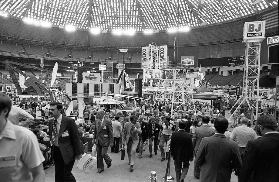 Thousands take in the array of material and equipment in 1982 at the 14th Offshore Technology Conference at the Astrodomain. Hundreds of exhibits blanketed the Astrodome, Astrohall and part of the parking lot for the four-day meeting. Photo: Darrell Davidson, HC Staff / Houston Chronicle / © Houston Chronicle