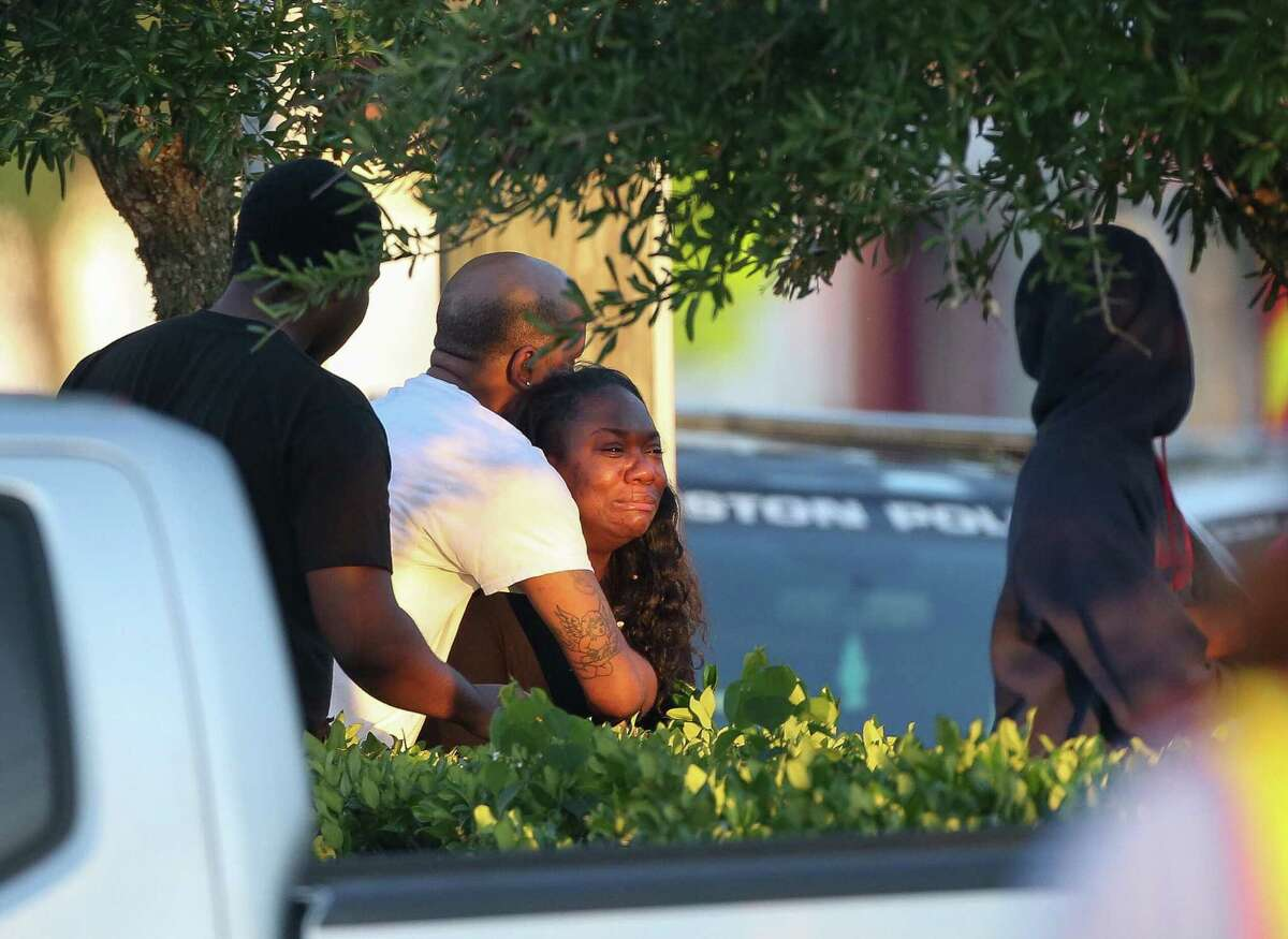 The mother, center, of 14-year-old Seyvion Farley grieves as the Houston Police Department investigates the scene of a two-vehicle fatal crash on West Fuqua Street, near Bathurst Drive Wednesday, April 25, 2018, in Houston. Farley, who was in the passenger seat, was one of two teens killed in the wreck.