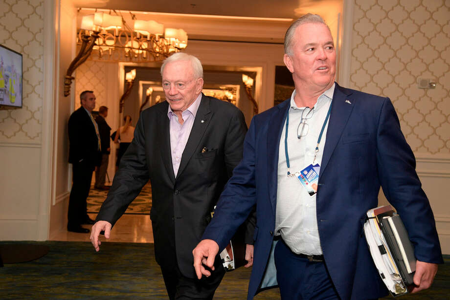 "In this March 28, 2018, file photo, Dallas Cowboys owner Jerry Jones, left, and director of player personnel Stephen Jones leave a conference room during the NFL owners meetings in Orlando, Fla. With Dez Bryant gone, the Dallas Cowboys have to decide if they will use their top pick on a receiver for the first time since taking him eight years ago. The answer on going that high to get another target for quarterback Dak Prescott, as it was before Bryant's release this month, is an emphatic ""maybe."" (Phelan M. Ebenhack/AP Images for NFL, File)"