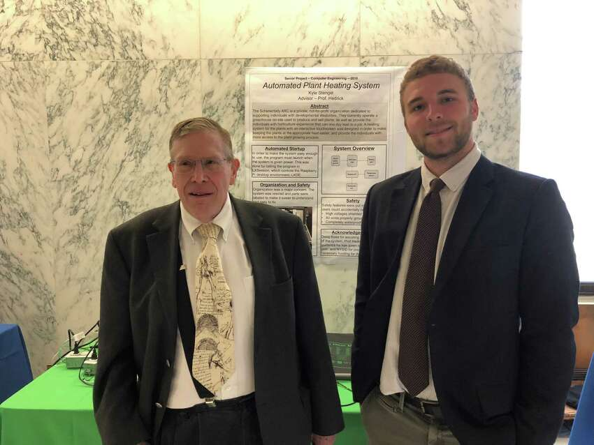 Union College professor James Hedrick, left, and computer engineering senior Kyle Stengel present their automated plant heating system at the annual CREATE symposium, held at the Legislative Office Building on State Street in Albany. (Jennifer Patterson / Times Union)
