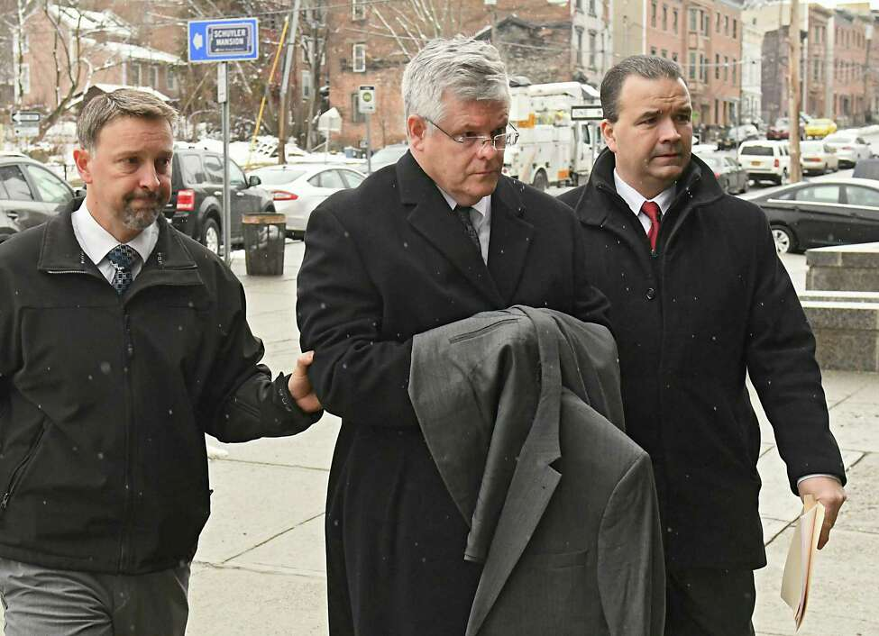 Richard J. Sherwood, town justice in Guilderland, is brought into City Court by police officers after being arrested on Friday, Feb. 23, 2018, in Albany, N.Y. (Lori Van Buren/Times Union archive)