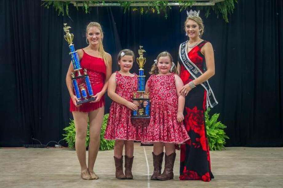 The Jersey County Fair 2017 talent senior and junior champions, Autumn Sturhahn of Quincy, and Emma and Anna Beauchamp of Jerseyville were in the top 10 of their respective divisions at the state competition in Springfield in January. Sturhahn took 9th place and Emma and Anna Beauchamp were in 6th place. They are pictured with the 2016 Miss Jersey County, Kallie Shires. Photo:       For The Telegraph