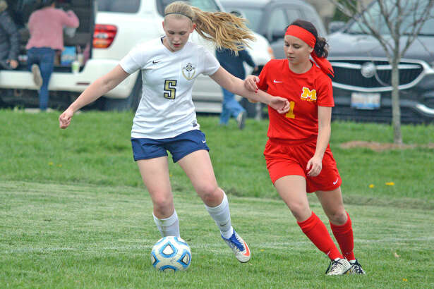 Father McGivney freshman Rachel Maller, left, controls the ball during the first half of Wednesday's home game against Murphysboro.