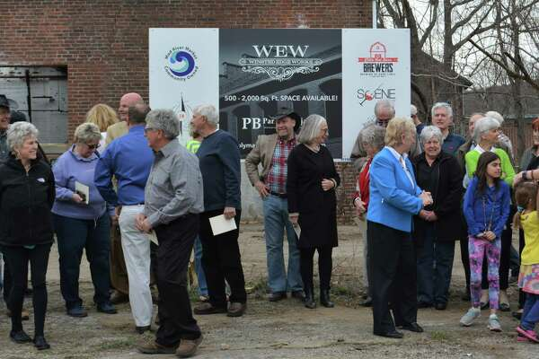 Supporters and town officials celebrate at the grand opening of Winsted Edge Works on Tuesday.