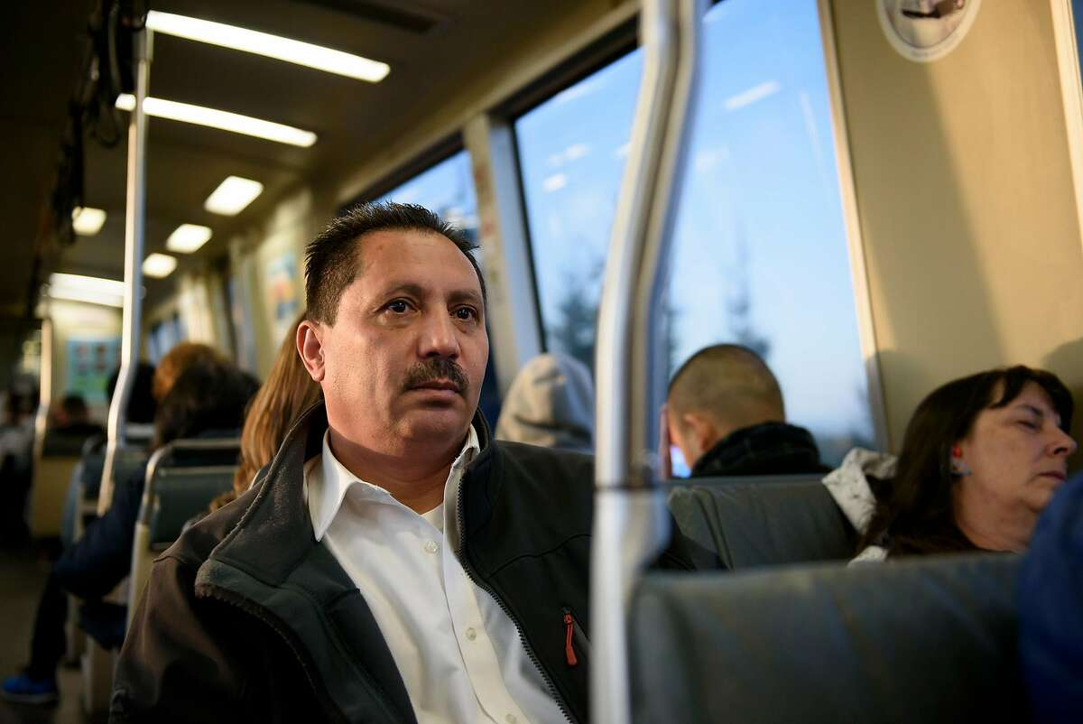 Cody Qudratullah rides on BART while commuting to his job at the Bohemian Club in San Francisco, from his home in San Leandro, CA, on Thursday April 19, 2018.