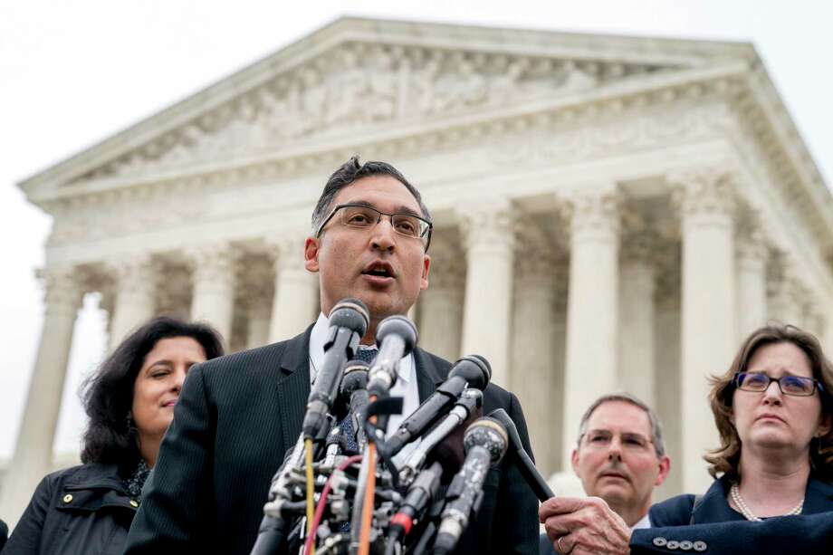 Neal Katyal, the attorney who argued against the Trump administration in the case Trump v. Hawaii, speaks to members of the media outside the Supreme Court, Wednesday, April 25, 2018, in Washington. President Donald Trump appears likely to win his travel ban case at the Supreme Court. Chief Justice John Roberts and Justice Anthony Kennedy both signaled support for the travel policy in arguments at the high court. The ban's challengers almost certainly need one of those two justices if the court is to strike down the ban on travelers from several mostly Muslim countries. (AP Photo/Andrew Harnik) Photo: Andrew Harnik / Copyright 2018 The Associated Press. All rights reserved.