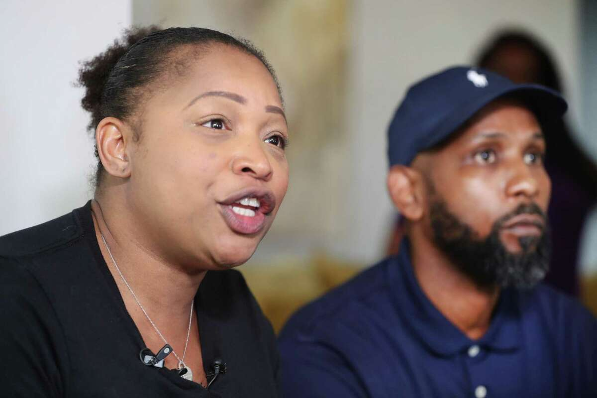 Kandice Webber who was arrested at HISD's board meeting and held at the Harris County Jail overnight talked to the media Wednesday, April 25, 2018, in Houston. Travis McGee, who has three children in HISD talked during the short media conference. ( Steve Gonzales / Houston Chronicle )