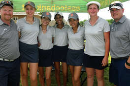 Seven Lakes Head Girls Golf Coach Sean Ewing, from left, players Grayson Heilman, Chelsea Teng, Isha Dhruva, Lauren Nguyen, and Kathryn Gleason, and Asst. Coach Mark Szafran are all smiles after winning the team title at the Region III-6A Girls Golf Championships at Eagle Pointe Golf Club in Mt. Belvieu on April 25, 2018. (Photo by Jerry Baker/For the Chronicle)
