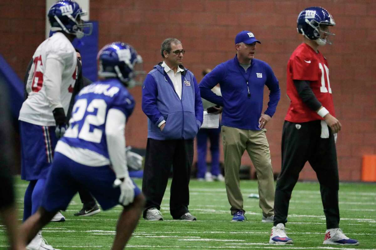 New York Giants general manager Dave Gettleman, center left, stands with head coach Pat Shurmur during NFL football training camp, Wednesday, April 25, 2018, in East Rutherford, N.J. (AP Photo/Julio Cortez)