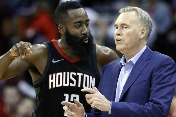 Houston Rockets guard James Harden (13) and head coach Mike D'Antoni talk during the second half of an NBA basketball game against the Miami Heat Monday, Jan. 22, 2018, in Houston. (AP Photo/Michael Wyke)