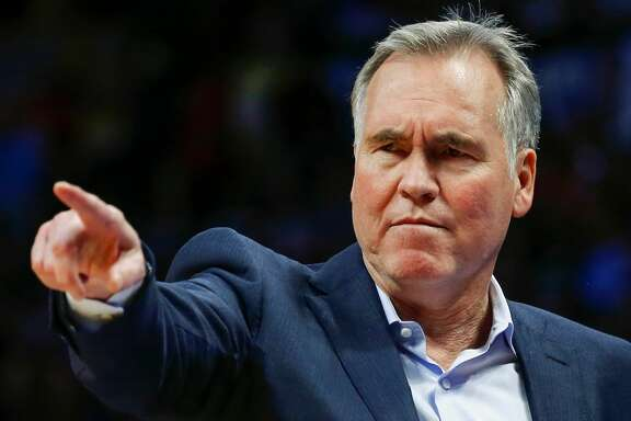 FILE - In this Feb. 25, 2018 file photo, Houston Rockets head coach Mike D'Antoni points to make a change against the Denver Nuggets during the third quarter of an NBA basketball game in Denver. Chris Paul has a long history of playoff heartbreak. So does James Harden. And D'Antoni has more than either of them combined. Separately, they've never gotten it done at playoff time. Together, their fortunes might change. They've led the Houston Rockets to the NBA's best record going into these playoffs. In a league that Golden State and Cleveland have dominated in recent years this might be the Paul-Harden-D'Antoni triumvirate that breaks through this spring. (AP Photo/Jack Dempsey, file)