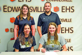 Edwardsviille senior Taylor Seilheimer will compete as a diver for the women's swim team at Lindenwood University. In the front row, from left to right are mother Michelle Seilheimer and Taylor Seilheimer. In the back row, from left to right, are EHS assistant coach Sam Shaw and EHS head coach Christian Rhoten.