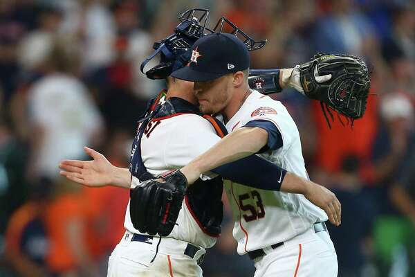 That's a wrap! Catcher Max Stassi congratulates Ken Giles on his first three-out save of the season, which helped the Astros avert an Angels sweep.