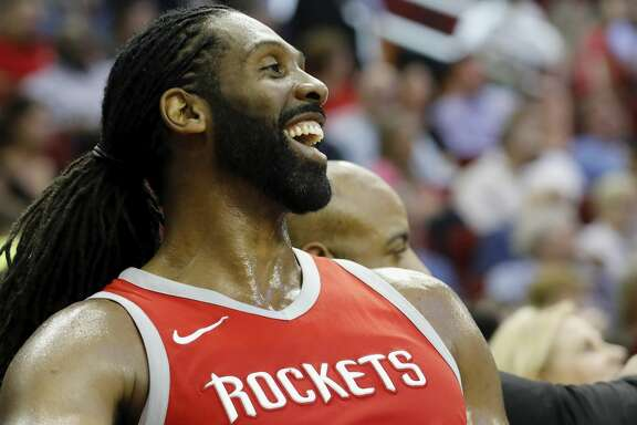 Nene Hilario #42 of the Houston Rockets reacts on the bench during the second half against the Washington Wizards at Toyota Center on April 3, 2018 in Houston, Texas.  NOTE TO USER: User expressly acknowledges and agrees that, by downloading and or using this Photograph, user is consenting to the terms and conditions of the Getty Images License Agreement.  (Photo by Tim Warner/Getty Images)