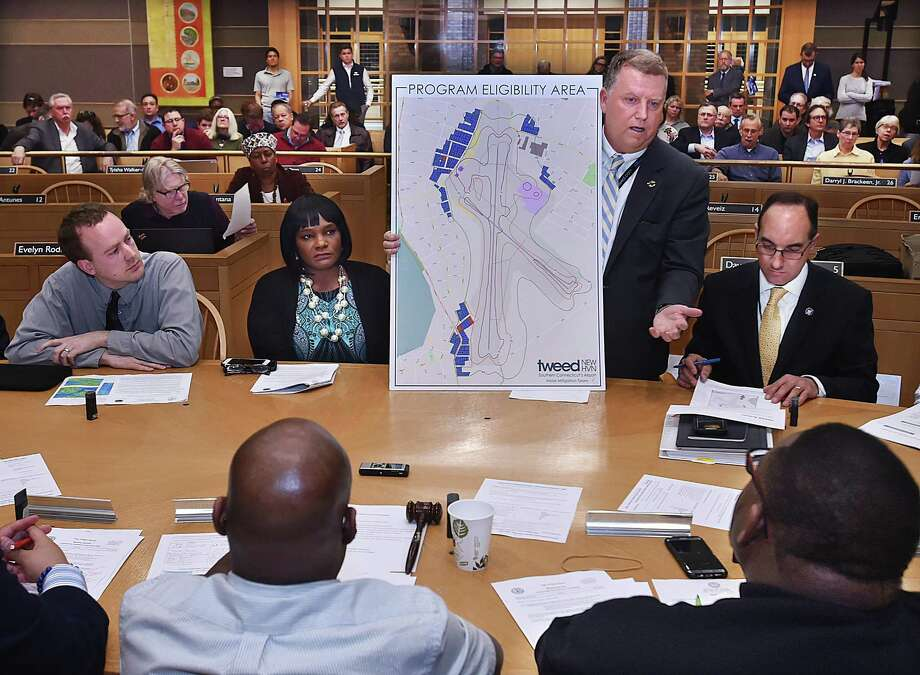 Tweed Authority Executive Director Tim Larson presents expansion plans Wednesday at a public hearing in New Haven. Seated from left are Giovanni Zinn, city engineer; Serena Neal-Sanjuro, executive director, Livable City Initiative; and Mike Piscitelli, New Haven deputy economic development administrator. Photo: Catherine Avalone / Hearst Connecticut Media / New Haven Register