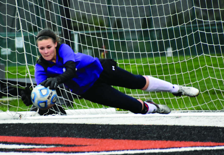 Edwardsville keeper Regan Windau makes a diving save to her right during the first half of Wednesday's non-conference game against St. Joseph's Academy inside the District 7 Sports Complex.