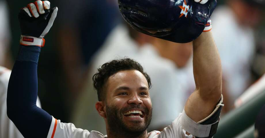 Houston Astros second baseman Jose Altuve (27) celebrates in the dugout after hitting a solo home run during the sixth inning of an MLB game against the Los Angeles Angels at Minute Maid Park Wednesday, April 25, 2018, in Houston. ( Godofredo A. Vasquez / Houston Chronicle ) Photo: Godofredo A. Vasquez/Houston Chronicle