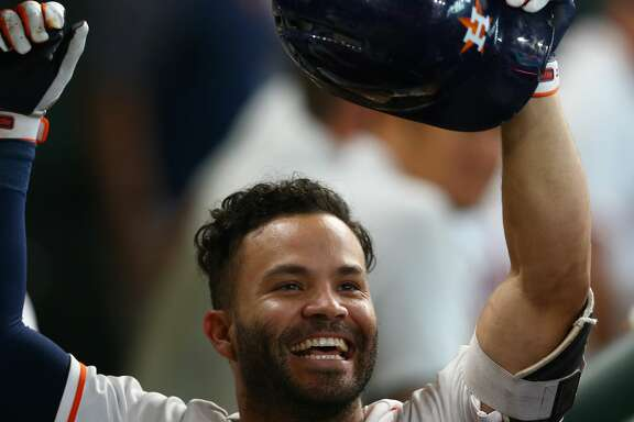 Houston Astros second baseman Jose Altuve (27) celebrates in the dugout after hitting a solo home run during the sixth inning of an MLB game against the Los Angeles Angels at Minute Maid Park Wednesday, April 25, 2018, in Houston. ( Godofredo A. Vasquez / Houston Chronicle )