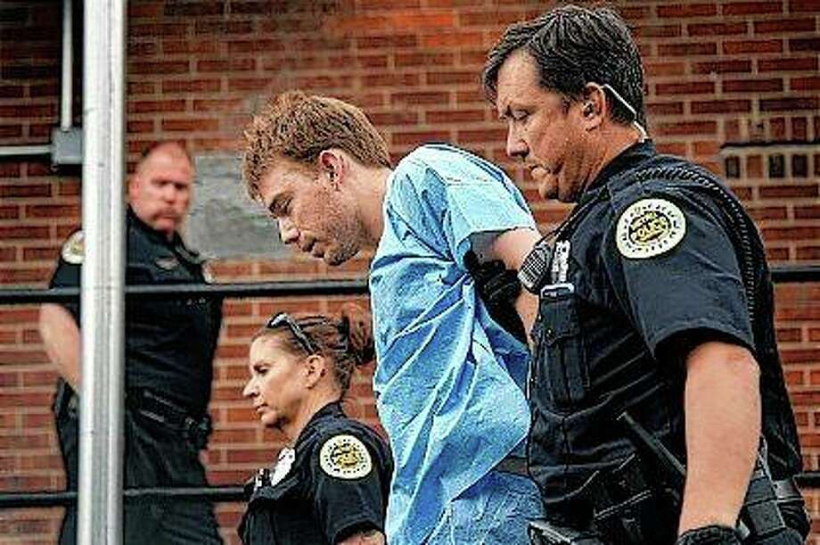 Travis Reinking, accused of killing four people in a late-night shooting at a Waffle House restaurant, is escorted into the Hill Detention Center in Nashville, Tennessee. Photo:       Lacy Atkins | The Tennessean (AP)