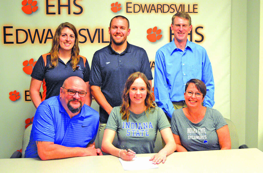 Edwardsville senior Emily Webb will swim for Indiana State University. In the front row, from left to right, are father Darren Webb, Emily Webb and mother Deb Boots. In the back row, from left to right, are EHS assistant coach Sam Shaw, EHS head coach Christian Rhoten and stepfather David Boots.