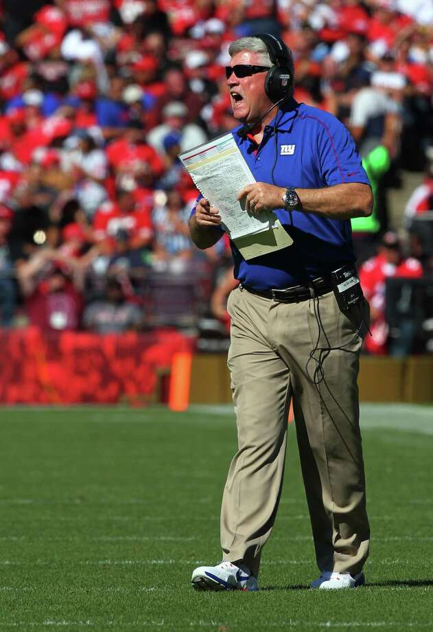 New York Giants offensive coordinator Kevin Gilbride yells instructions during an NFL game against the San Francisco 49ers on October 14, 2012. The Giants defeated the 49ers 26-3. AP Photo/Kevin Terrell) Photo: Kevin Terrell / AP / ONLINE_YES