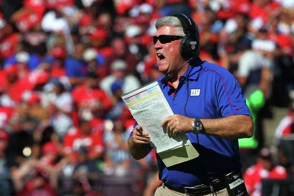 New York Giants offensive coordinator Kevin Gilbride yells instructions during an NFL game against the San Francisco 49ers on October 14, 2012. The Giants defeated the 49ers 26-3. AP Photo/Kevin Terrell)