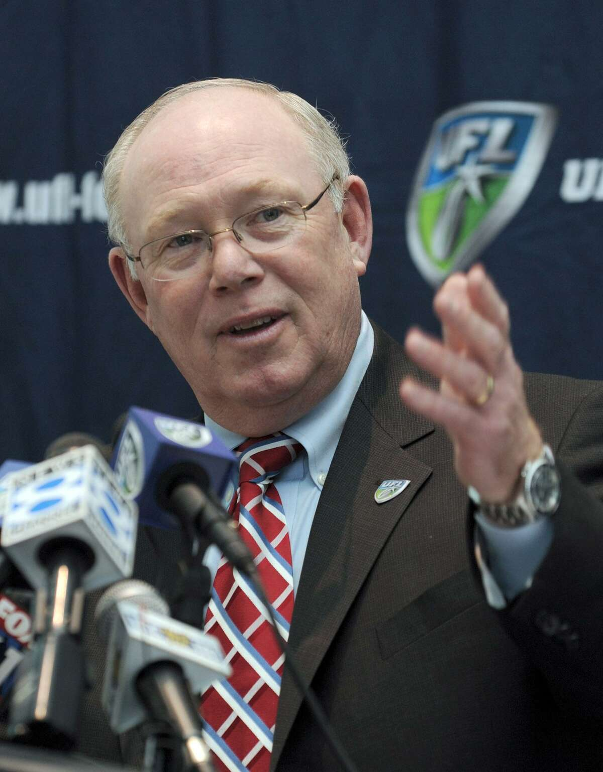 Chris Palmer, a Brewster native and Immaculate High School graduate, speaking at a press conference Tuesday at Rentschler Field in East Hartford. Palmer was named head coach of the United Football League's Hartford team.