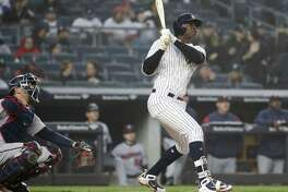 NEW YORK, NY - APRIL 25:  Didi Gregorius #18 of the New York Yankees hits a solo home run in the third inning against the Minnesota Twins at Yankee Stadium on April 25, 2018 in the Bronx borough of New York City.  (Photo by Elsa/Getty Images)