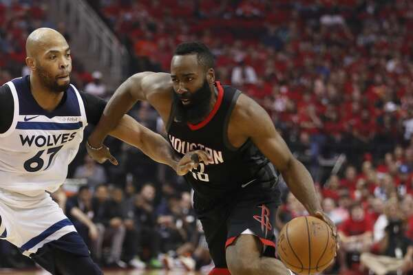 Houston Rockets guard James Harden (13) works against Minnesota Timberwolves forward Taj Gibson (67) in the first half of Game 5 of a playoff NBA basketball game at Toyota Center, Wednesday, April 25, 2018, in Houston. ( Brett Coomer  / Houston Chronicle )