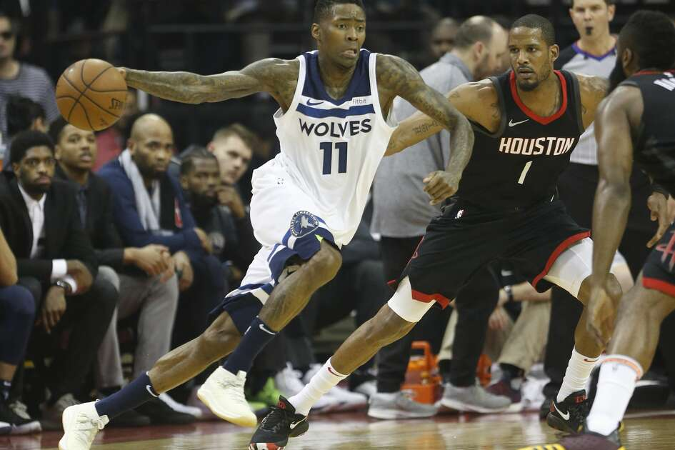 Minnesota Timberwolves guard Jamal Crawford (11) works around Houston Rockets forward Trevor Ariza (1) in the first half of Game 5 of a playoff NBA basketball game at Toyota Center, Wednesday, April 25, 2018, in Houston. ( Brett Coomer  / Houston Chronicle )