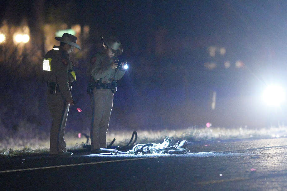 Texas Departement of Public Safety troopers work the scene of a motor vehicle accident that took the lives of two bicylists and sent at least one to the hospital April 25, 2018, on State Highway 158 between County Road 1250 and State Highway 191. James Durbin/Reporter-Telegram Photo: James Durbin