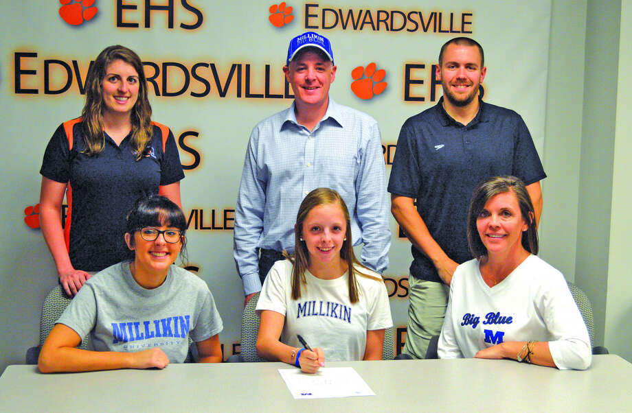 Edwardsville senior Hope Roderick will swim for Millkin University. In the front row, from left to right, are sister Madelyn Roderick, Hope Roderick and mother Lesley Roderick. In the back row, from left to right, are EHS assistant coach Sam Shaw, father Jeff Shaw and EHS head coach Christian Rhoten.