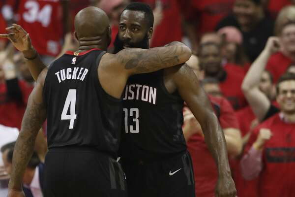Houston Rockets guard James Harden (13) hugs forward PJ Tucker (4)  in the second half of Game 5 of a playoff NBA basketball game at Toyota Center, Wednesday, April 25, 2018, in Houston. ( Brett Coomer  / Houston Chronicle )
