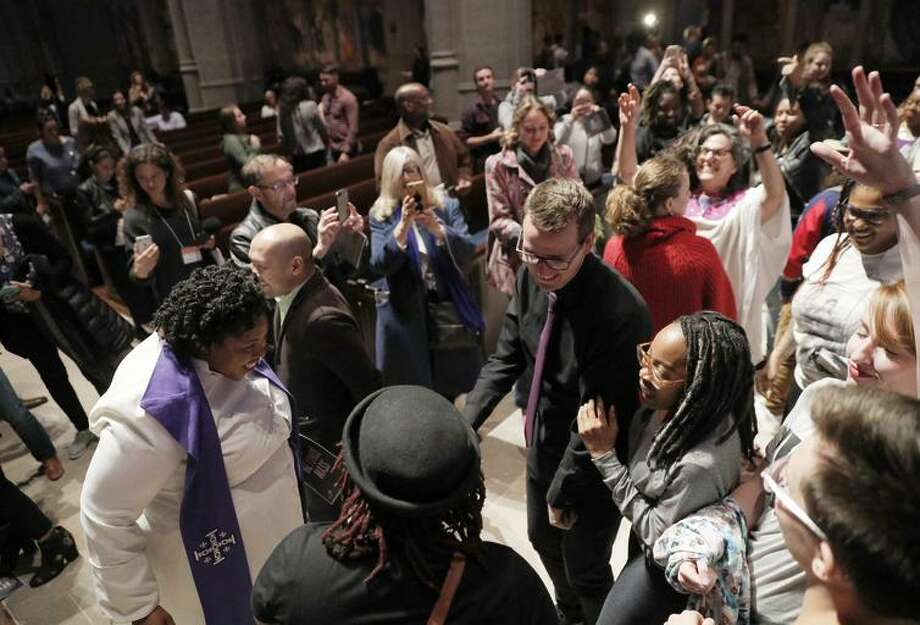 "The Rev. Yolanda Norton, of the San Francisco Theological Seminary gave a guest sermon on her current course ""Beyoncé and the Hebrew Bible"" dances with congregants at Grace Cathedral to celebrate the Beyonce Mass on Wednesday, April 25, 2017 in San Francisco, Calif. Photo: Carlos Avila Gonzalez / The Chronicle / ONLINE_YES"